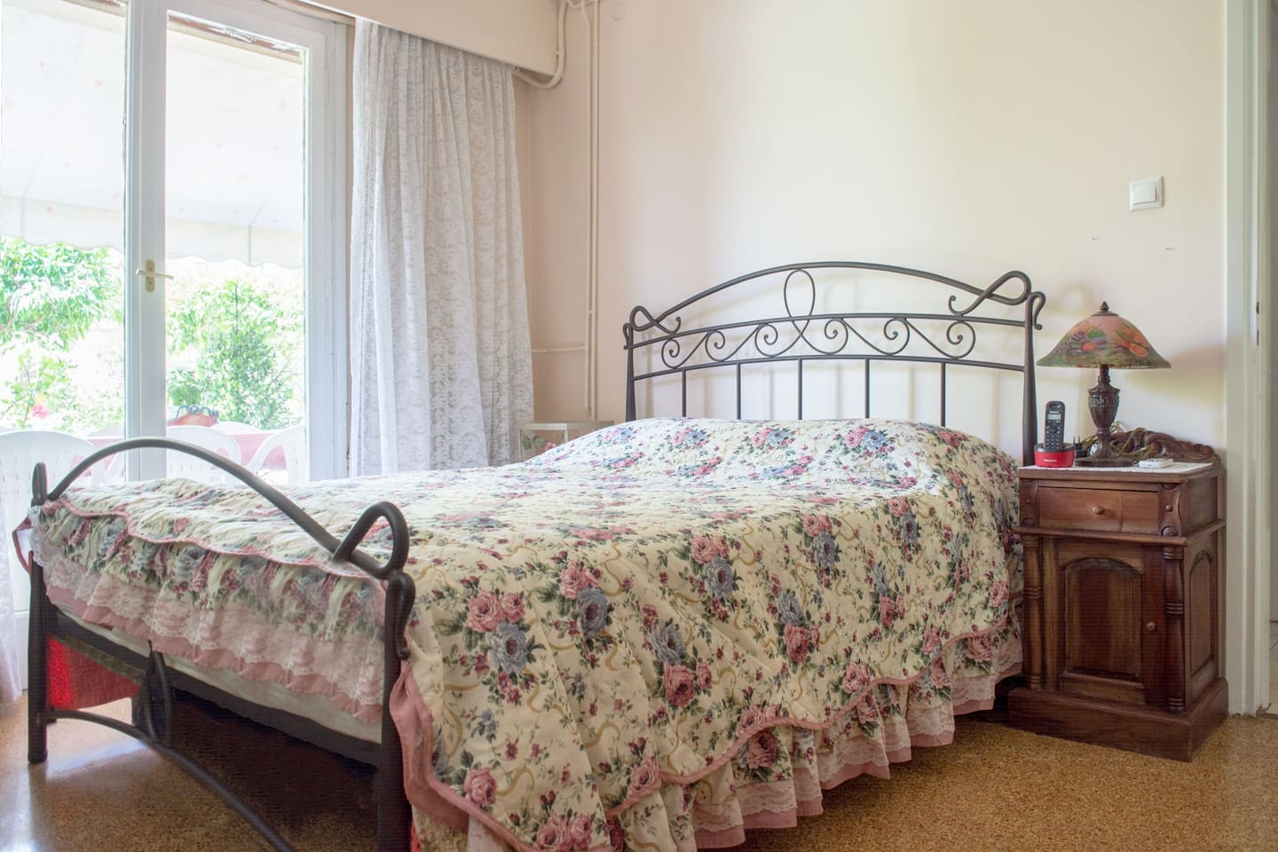 Bright and spacious master bedroom with an extra comfortable double bed and access to the front balcony.