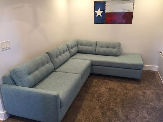 Sitting room outside of master. Perfect sofa bed for small kids to have near parents.