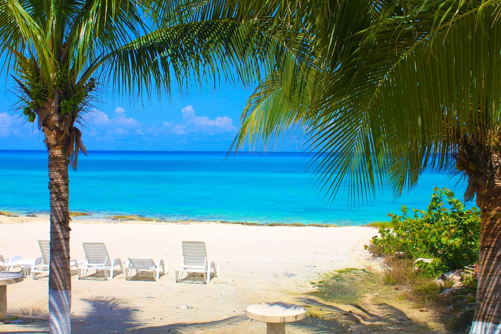 Beautiful quiet, private walk out beach with lounge chairs