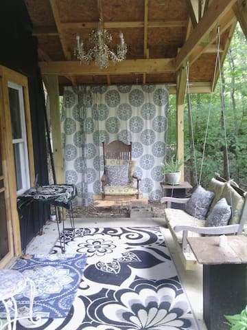 Porch where you can swing and enjoy wine, coffee or tea.