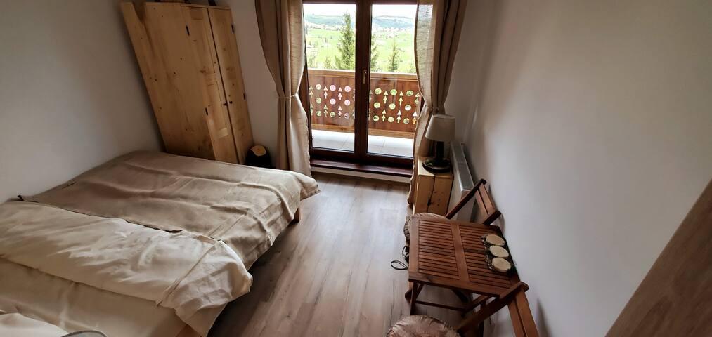 First floor bedroom with balcony