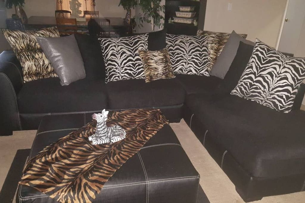 Guests are welcome to relax on the couch in the living room.