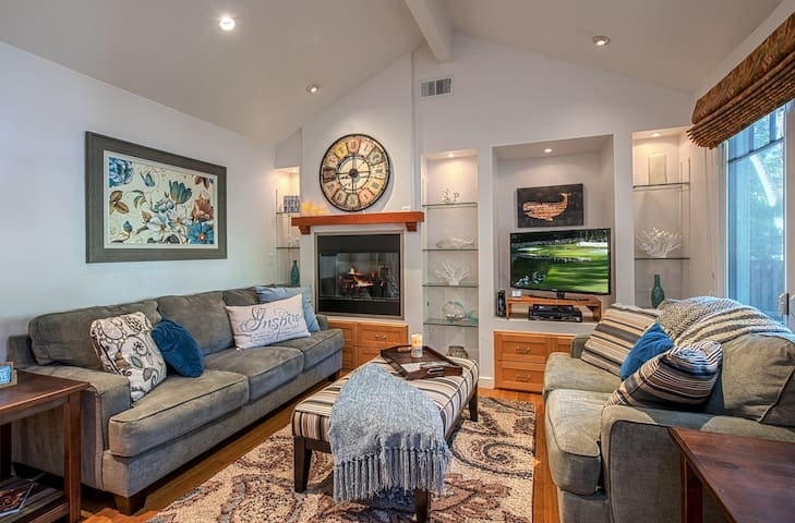 Living Room ~ relax in front of a gas fireplace and watch a 32-inch HDTV from comfortable couches.