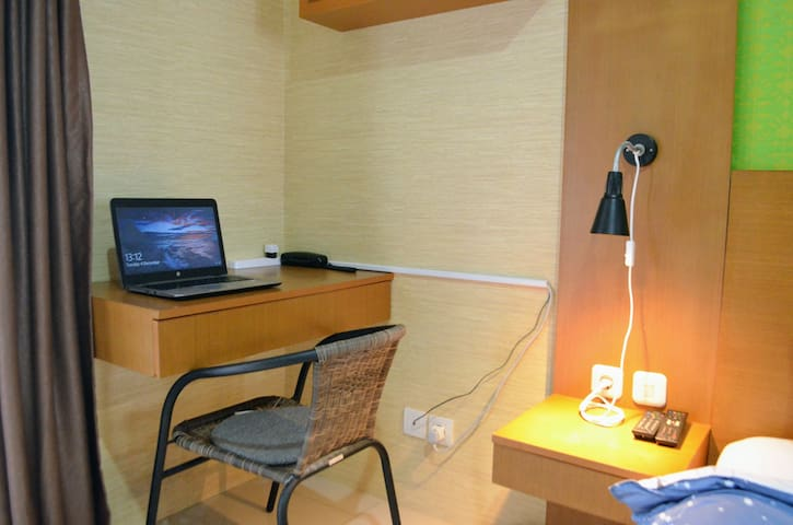 Working desk for laptop. Flexible bed side light.