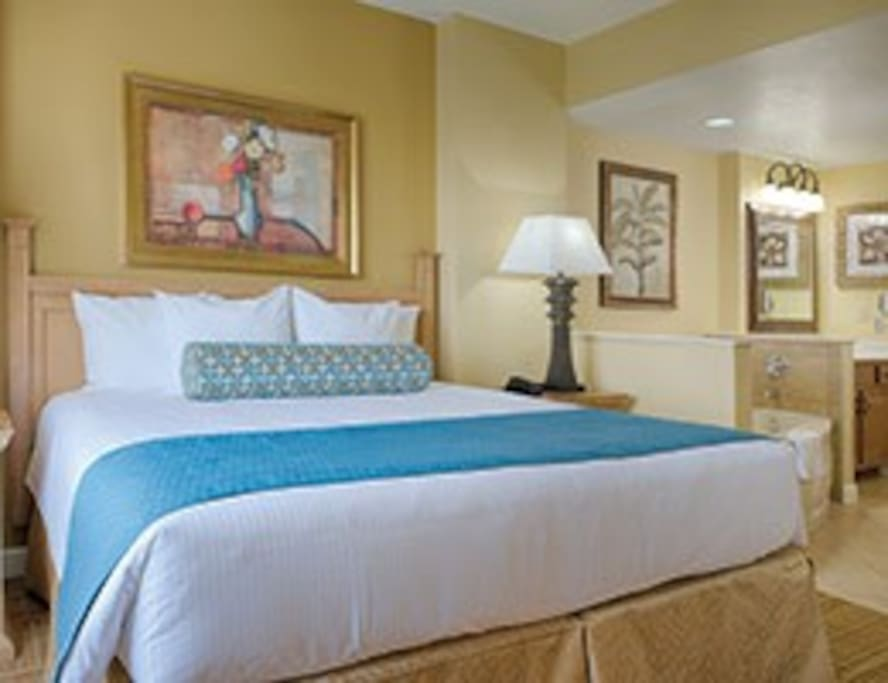 Deluxe unit Master bedroom with a King bed, jetted tub and attached bathroom.