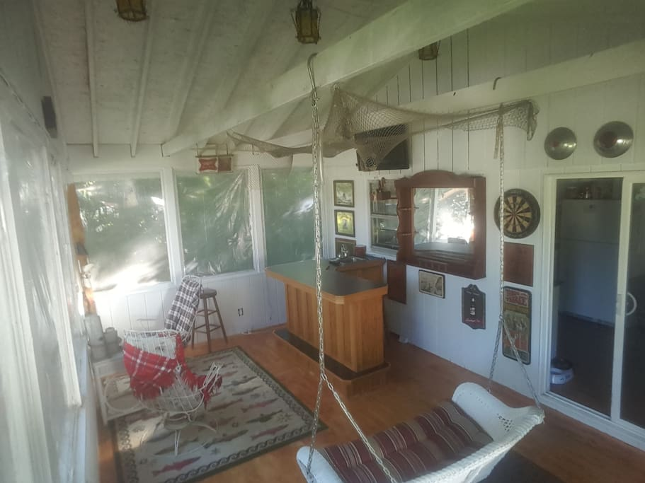 Updated Paint and floors!Still same great view of backyard, With tv, dart board and disco lights