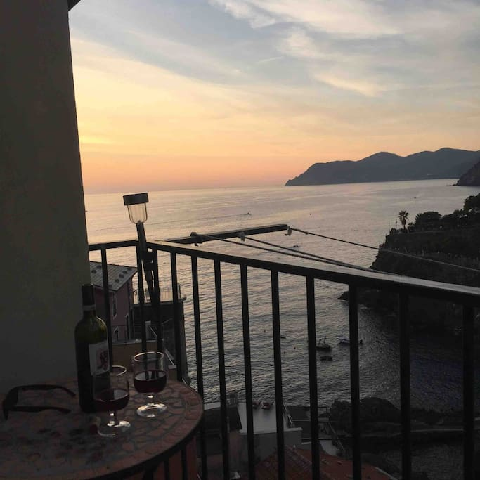 Drink wine in the sunset from the terrace of the Open Mind Apartment.