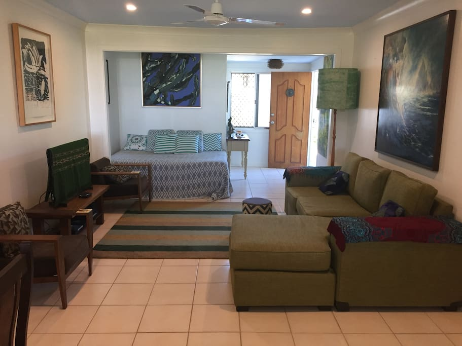 Your generous lounge area with day bed and brand new smart TV