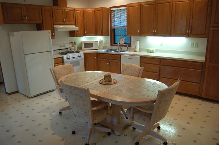 Full kitchen area with gas stove, microwave, refrigerator, dishwasher, etc.