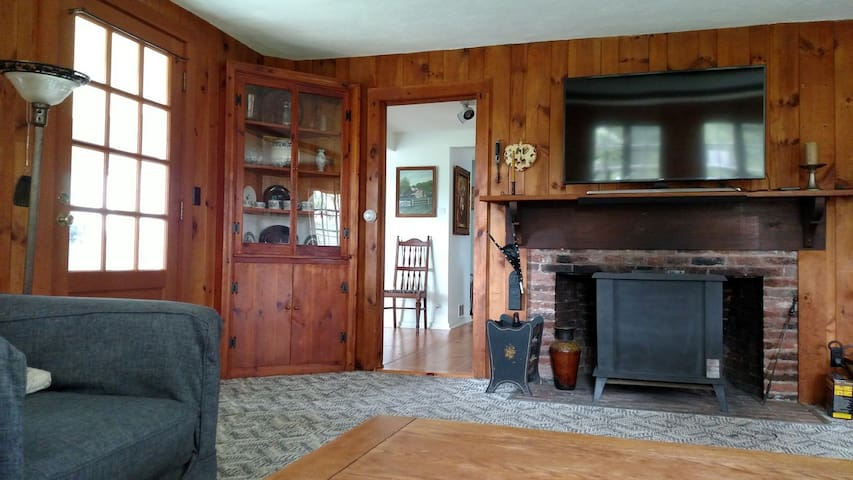 """The living room has a wood stove and 50"""" (127 cm) Smart TV (Netflix provided)."""