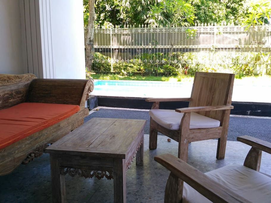 Outdoor space in front of pool