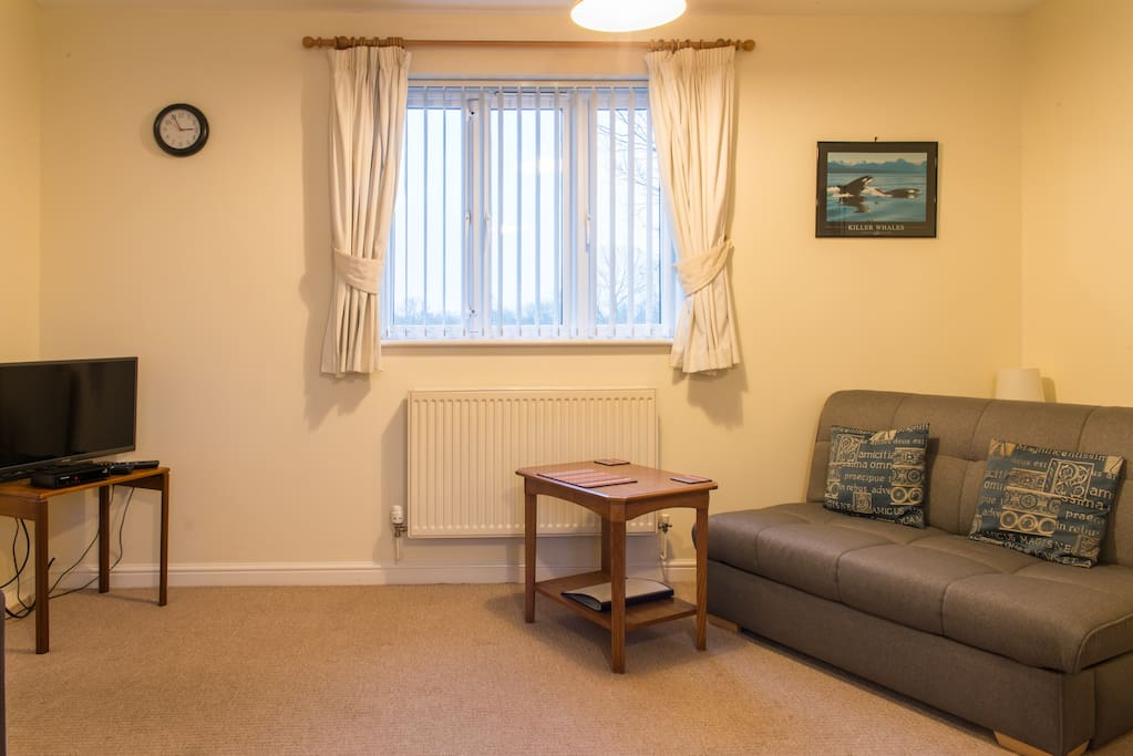 Comfortable lounge with sofabed, dining table, excellent WiFi and Freesat TV and CD player