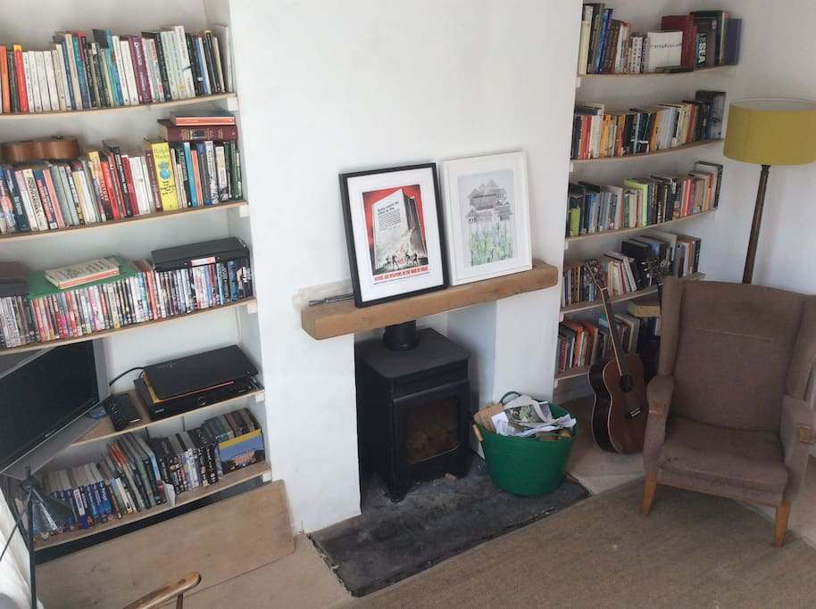 Front room (TV with freeview, wood-burning stove, lounge chair)
