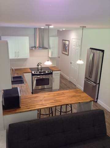 Kitchen with all amenities, open to living room.