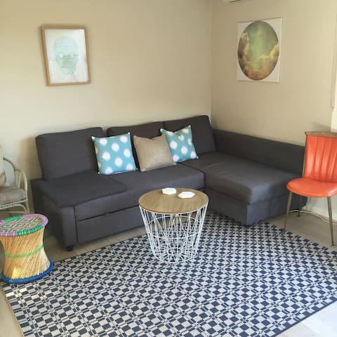 Our light and bright living room- very comfy fold out sofa.