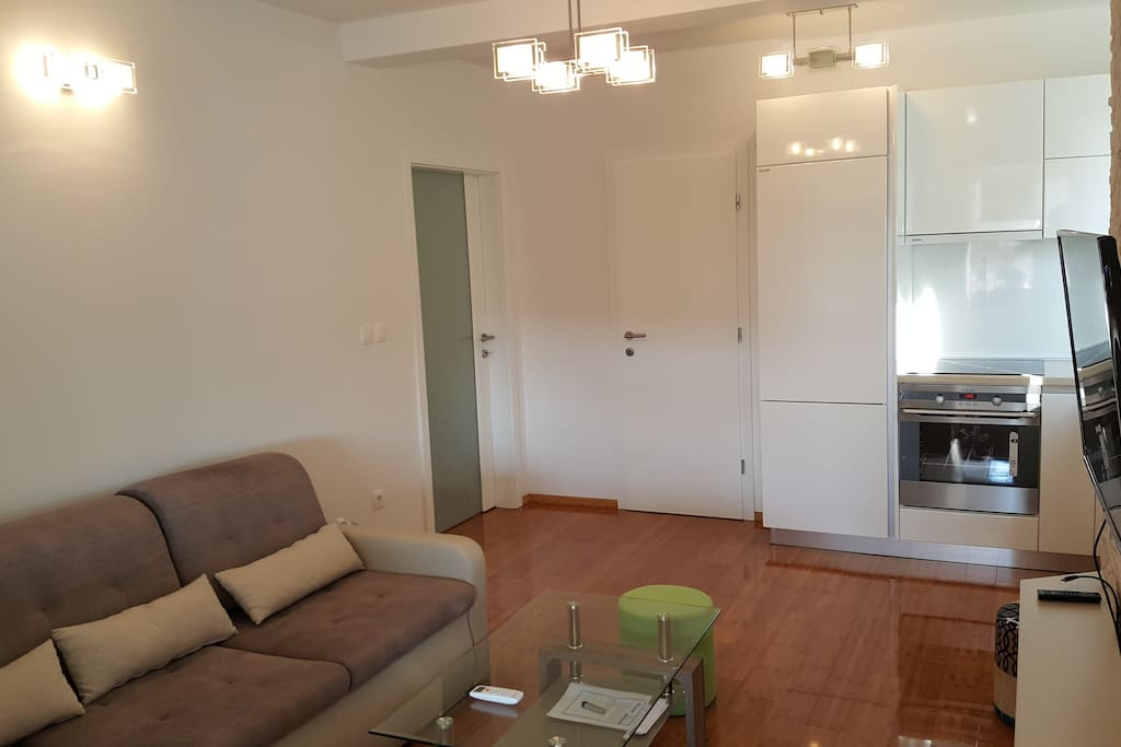 Large living room with kitchen