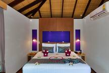 Romantic bedroom on the peaceful and natural area of the resort.