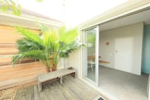 garden bedroom private deck with views through the garden & trees down to the beach and Atlantic Ocean