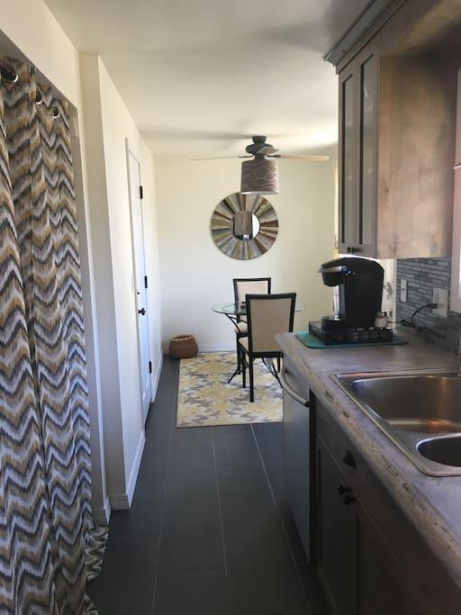 Kitchen with washer/dryer nook.