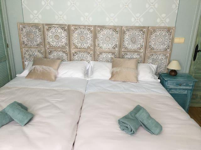 dormitorio dos camas de 1,05 cada una