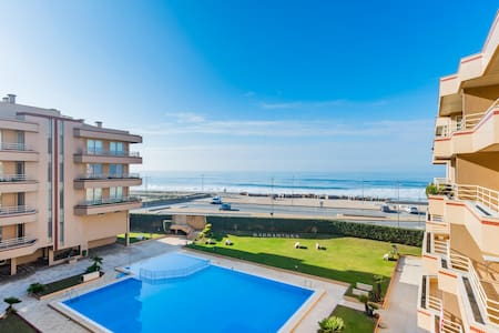 First line, two swimming pool, side surfcamp Porto