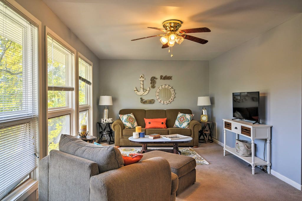 Relax in the living room boasting plush sofas and a flat-screen cable TV!