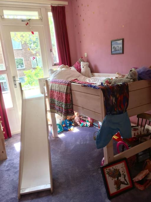 The single bedroom comes complete with a slide!