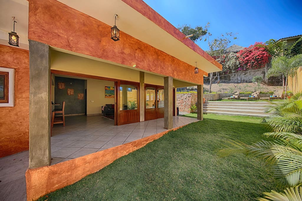 Sliding doors that open to a nice meticulous yard.