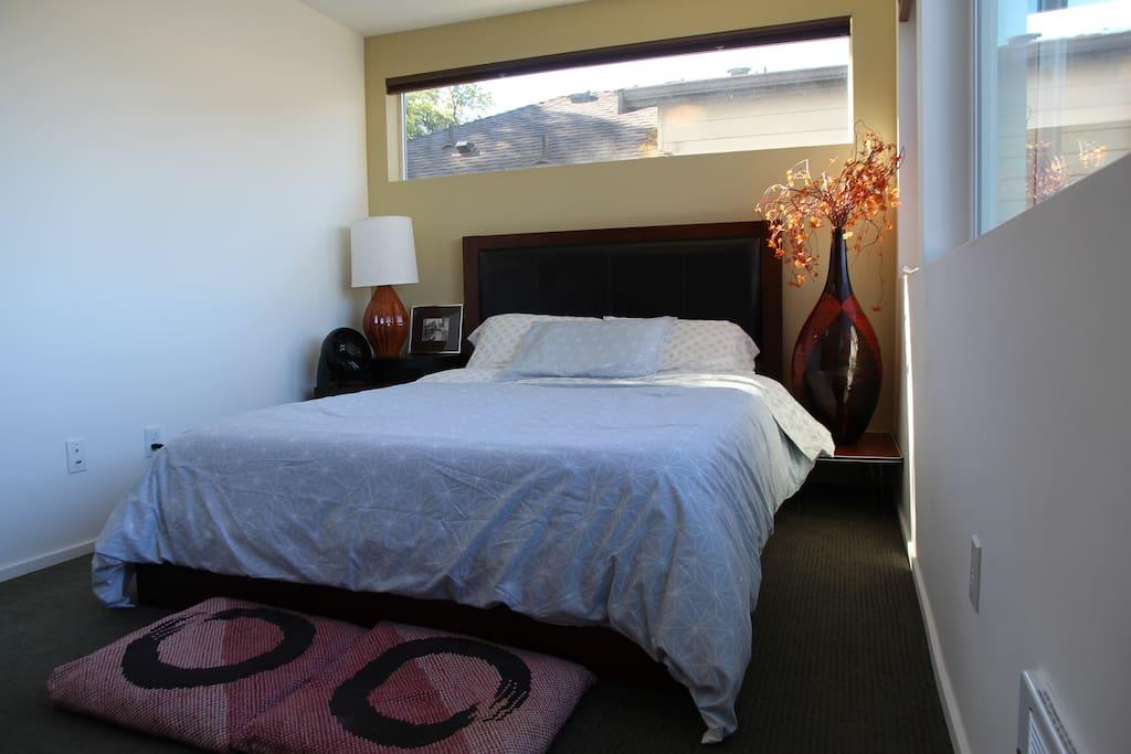 Guest bedroom with Queen-sized bed and door lock