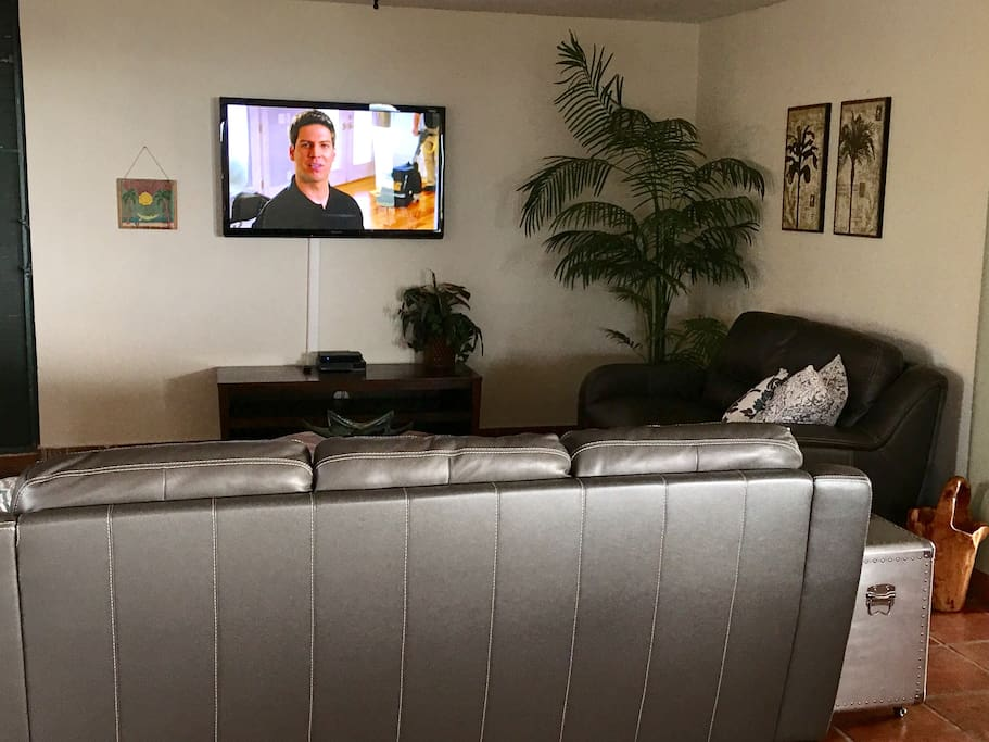 "Living room has 54"" TV with basic cable & DVD player"