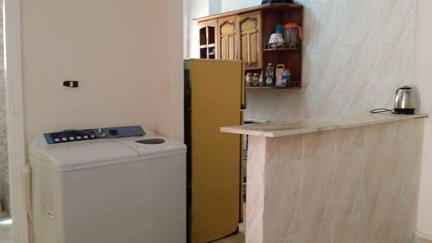 American kitchen next to the washing machine with the possibility of providing laundry and ironing service at another price.