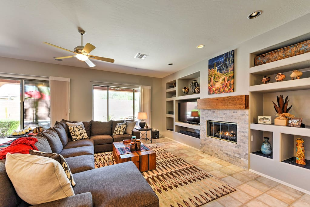 Turn on the gas fireplace to stay warm as you watch shows on the flat-screen TV.