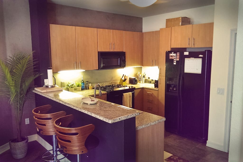 Full kitchen that is completely stocked with everything you need to cook & eat at home