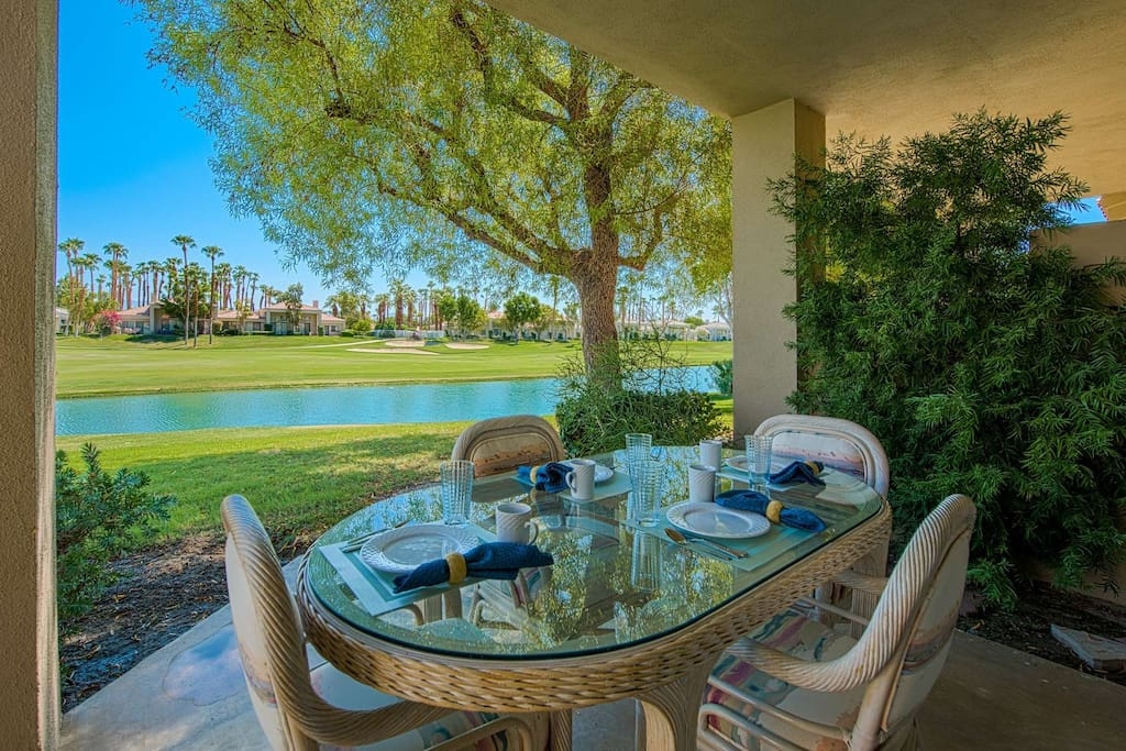 Outdoor Dining Area with View of Lake and Golf Course