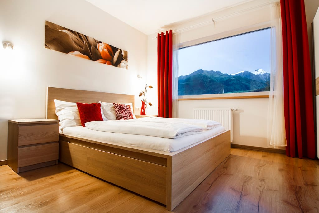 Enjoy the view of the Alps right from your comfortable bed.