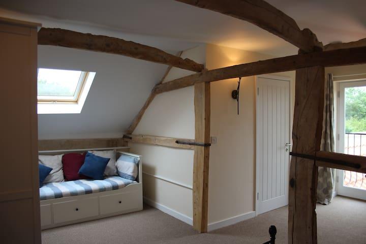 sofa bed looking towards juliet balcony.
