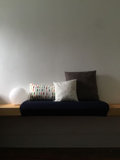 Another photo of the comfy seating and your bedside lamp.