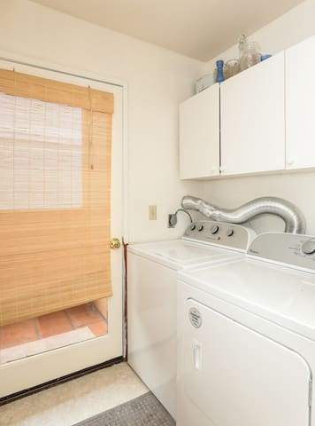 Newer washer and dryer, adjacent to upstairs half bath.