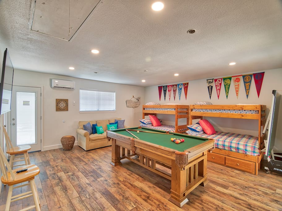 New Bunk Room with 2 twin over full bunk beds, sleeper sofa, 65 in smart tv, pool table, ping-pong