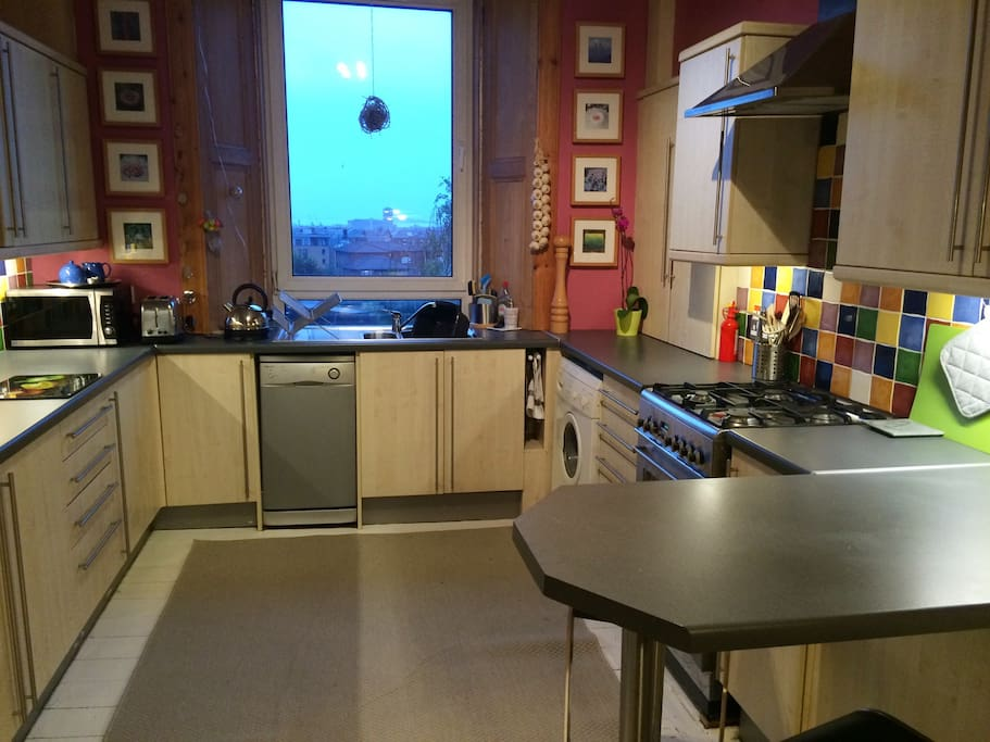 Large rear facing dining kitchen with breakfast bar and separate dining area. Views towards the Firth of Forth