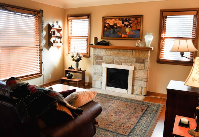 Sunny and inviting reading room with electric fireplace.
