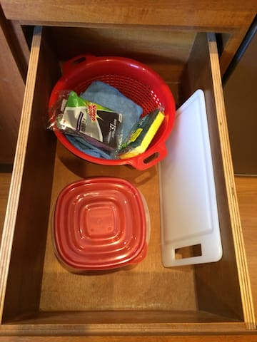 And what is inside drawer #2? Basic cleaning supplies. Woo Hoo!  Oh oh...: please, please, please. The countertop is crazy beautiful and also very hard. Still, the varnish isn't quite as durable. We have a few cutting boards for you to choose from.