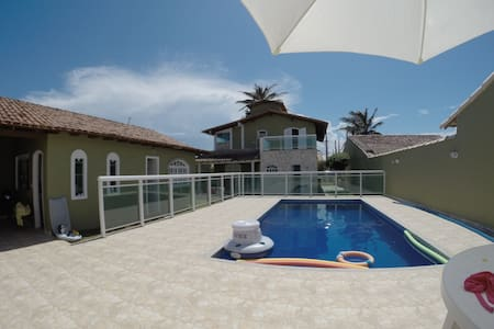 Casa perto da  praia com piscina e churrasqueira