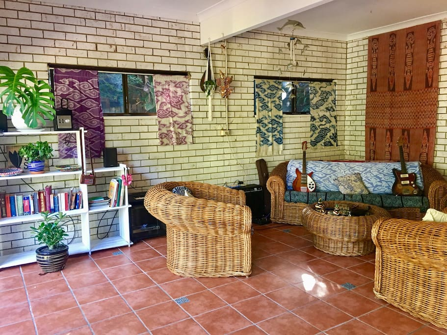 spacious studio with large 4 seater couch and 2 single armchairs where you can relax after your day on the beach