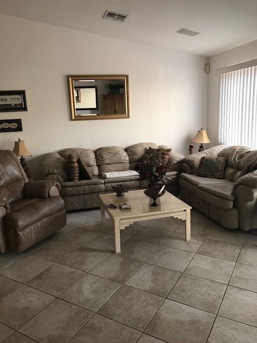 Living Room with Flat Screen Tile Floors