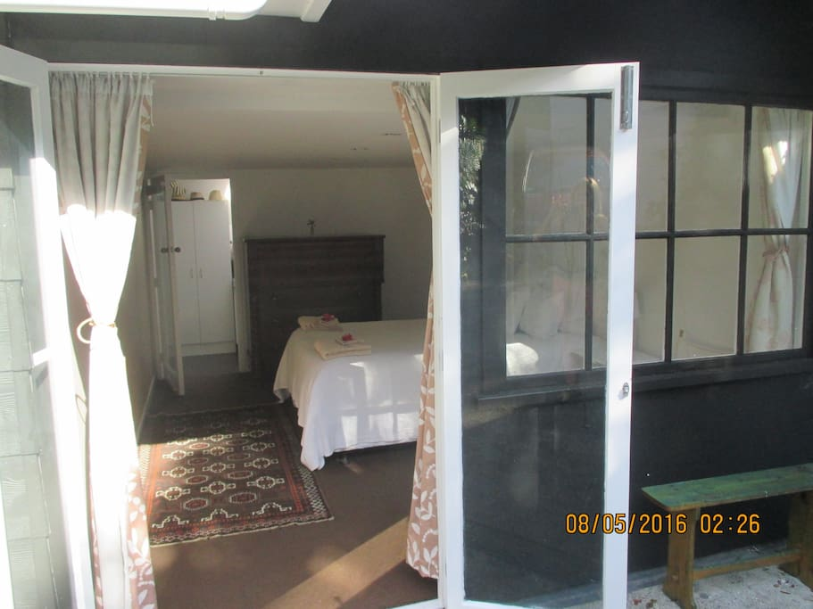 Entrance through French doors to Bedroom