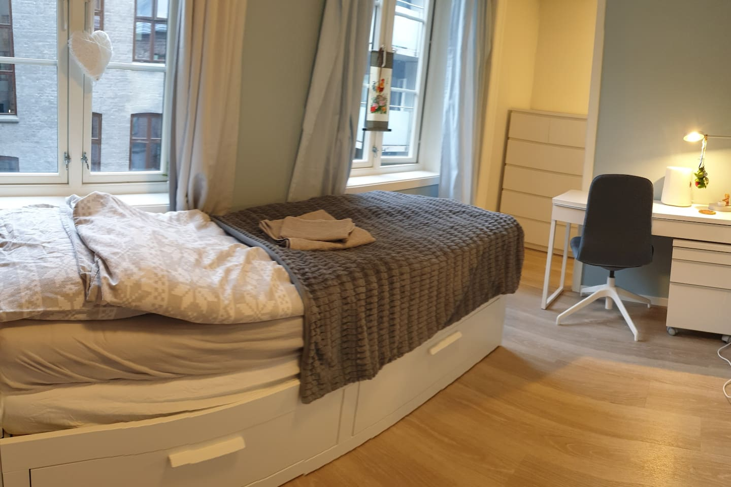Modern room with lots of light. Heated floor with a thermostat. Adjacent storage and closet room is part of the room.