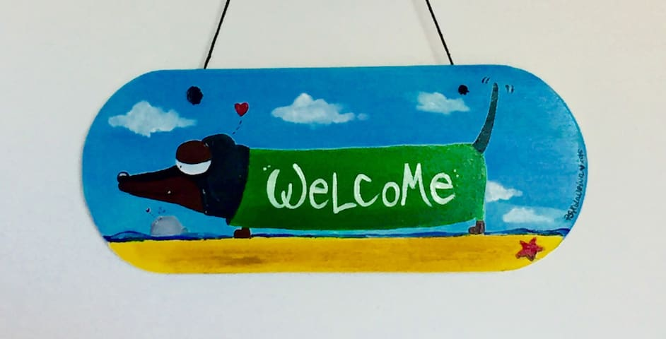 """Our """"Bassotta"""" (Dachshund dog) welcomes you in our home! :-)"""