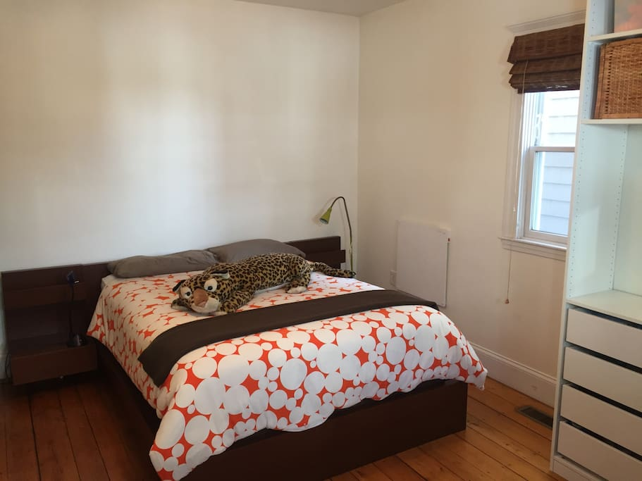 Queen-sized bed in 1st bedroom