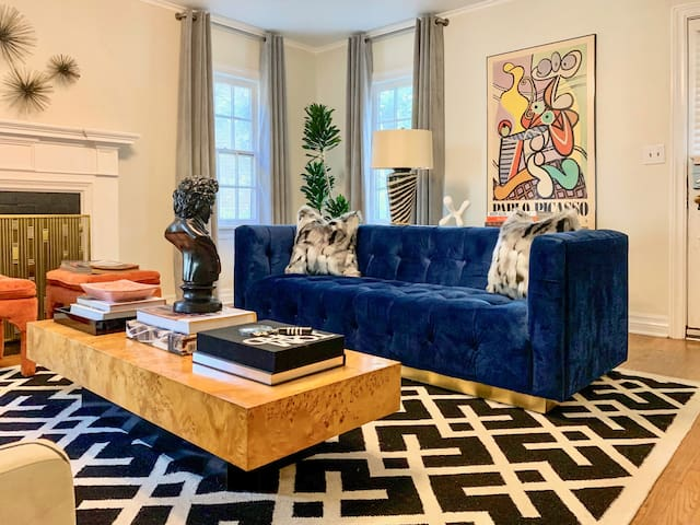beautiful velvet on brass modern couch with tons of art and accessories to check out